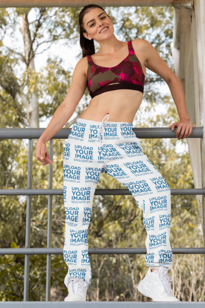Mockup of a Woman Pointing at Her Sublimated Sweatpants 29869