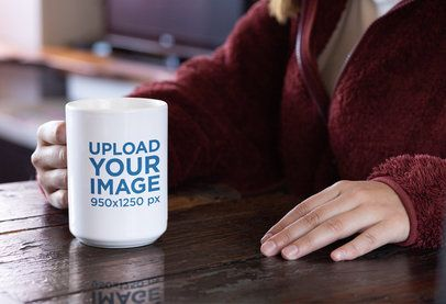 15 oz Coffee Mug Mockup Featuring a Woman Sitting at a Wooden Table 30124