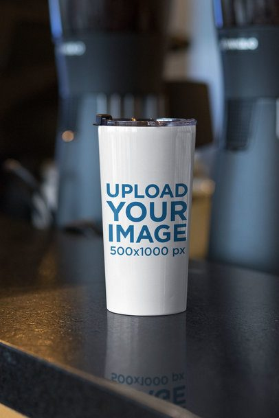 Travel Mug Mockup Placed on a Kitchen's Bar 30381