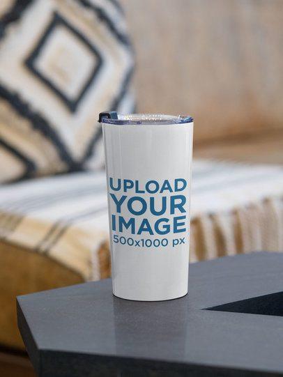 Mockup of a 20 oz Travel Mug on a Black Surface 30396