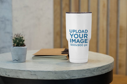 Mockup of a 30 oz Travel Mug on a Concrete Table 30403
