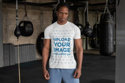 T-Shirt Mockup Featuring a Tough-Looking Man at a Boxing Gym 30171