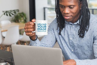 Mockup of a Man with Long Hair Holding an 11 oz Coffee Mug at an Office 30307