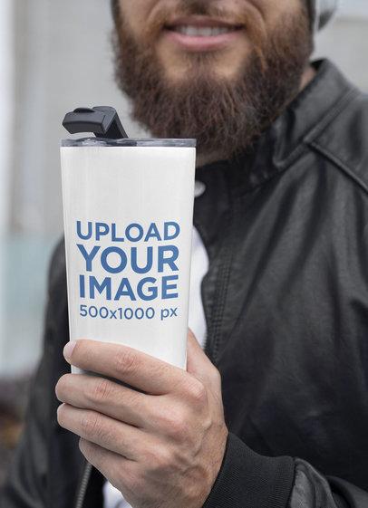 Mockup of a Bearded Man Wearing a 20 oz Travel Mug in Winter 30383