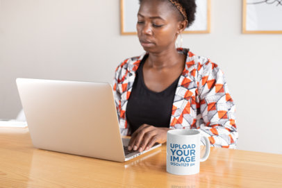 11 oz Coffee Mug Mockup Featuring a Woman Working 30324