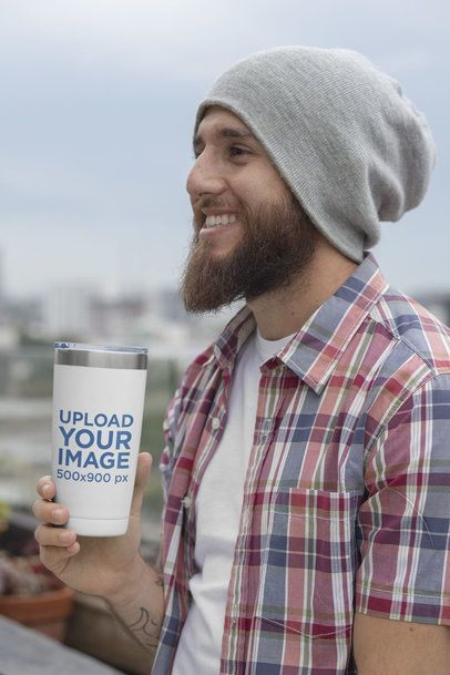 Mockup of a Happy Bearded Man Holding a 20 oz Travel Mug 30389