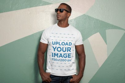 T-Shirt Mockup Featuring a Man Wearing Sunglasses by a Painted Wall 30450
