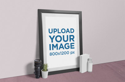 Mockup Featuring a Photo Frame Placed Next to a Plant Pot and a Camera Lens 889-el