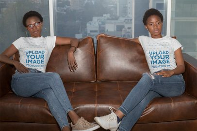 T-Shirt Mockup of Mother and Daughter Sitting on a Couch 30629