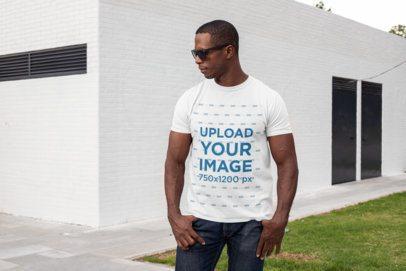 Mockup of a Muscular Man Wearing a T-Shirt at a Backyard 30454