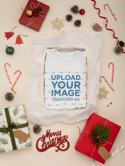 Mockup Featuring a Folded T-Shirt Surrounded by Xmas Decorations 30642