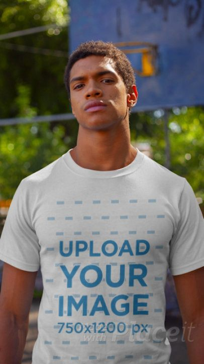 T-Shirt Video Featuring a Serious Man at a Basketball Court 22621