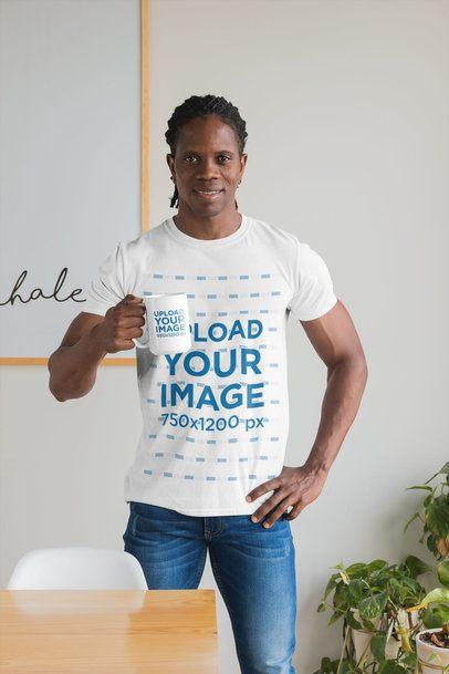 T-Shirt Mockup Featuring a Man Holding a 15 oz Mug at Home 30309