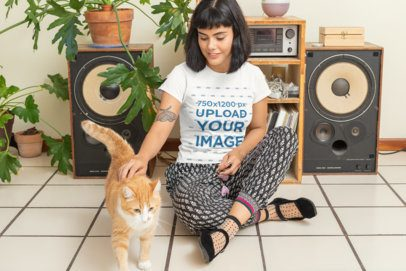 T-Shirt Mockup Featuring a Woman and Her Cat at Home 30669