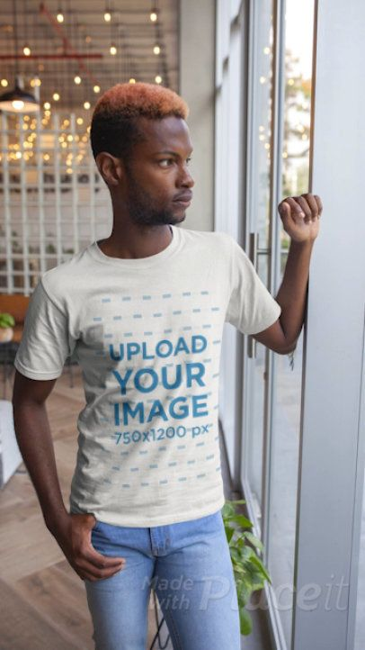 Stop Motion T-Shirt Video of a Man Standing By a Window 22539