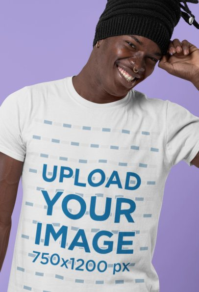 Mockup of a Smiling Man Wearing a T-Shirt and Posing at a Studio 30546
