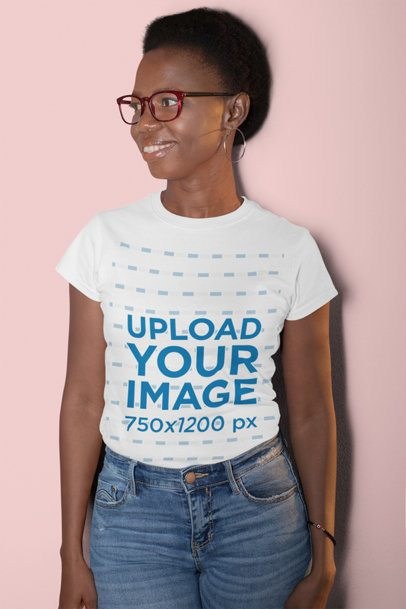 T-Shirt Mockup Featuring a Smiling Woman with Short Hair at a Studio 30628