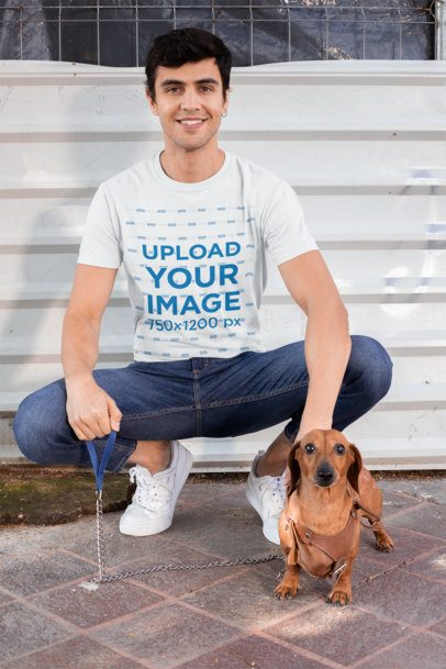 T-Shirt Mockup of a Man Posing with His Dog 30684
