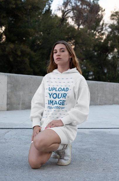 Mockup of a Woman Wearing a Hoodie Dress in an Urban Setting 30573