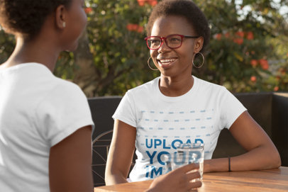 T-Shirt Mockup Featuring a Mother and Daughter Talking at a Table 30624