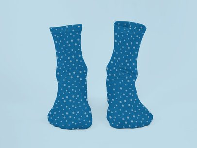 Ghosted Mockup of a Pair of Sublimated Socks with Customizable Background 29521