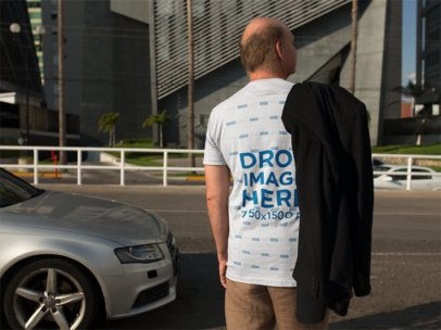 Elder Man Wearing a T-Shirt Mockup Standing Near Sports Car a11124