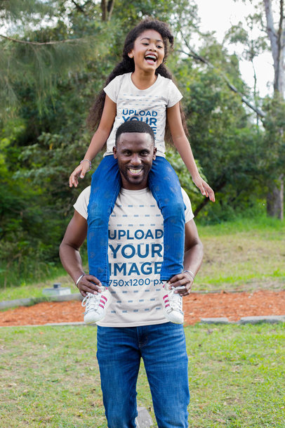 T-Shirt Mockup of a Man Carrying His Daughter on His Shoulders 30598