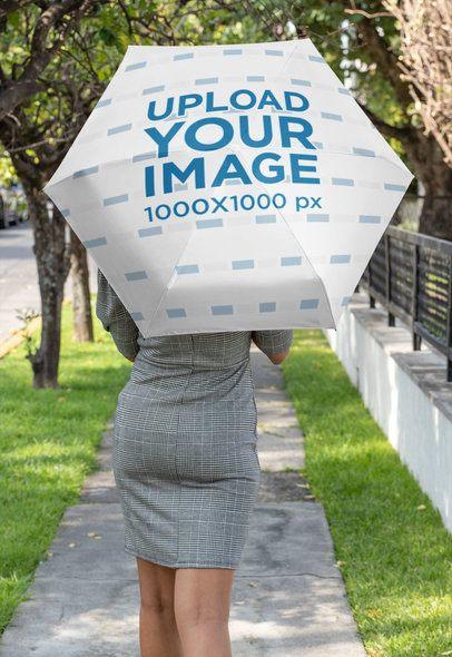 Umbrella Mockup Featuring a Woman Walking Down the Street 30740
