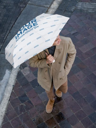 Zenith Shot Mockup Featuring a Smiling Man Holding an Umbrella 30721