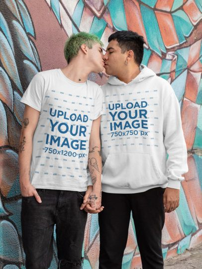 Mockup of an LGBT Couple Wearing a Tee and a Hoodie by a Cool Wall 30439