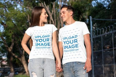 T-Shirt Mockup Featuring a Couple Holding Hands at a Park 30745