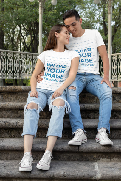 T-Shirt Mockup of a Romantic Couple Sitting on the Stairs 30743