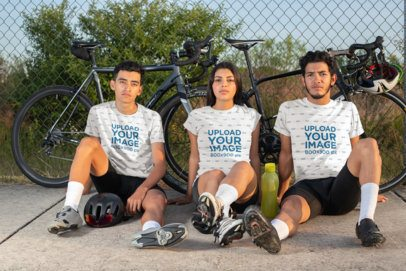 T-Shirt Mockup of Three Friends Sitting by Their Bicycles 30804