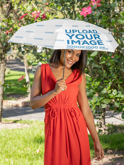 Umbrella Mockup Featuring a Smiling Woman by a Flower Plant