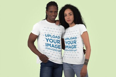 T-Shirt Mockup Featuring a Man and a Woman at a Studio 30759