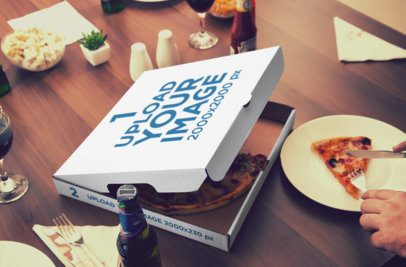 Mockup of an Open Pizza Box Placed Next to a Person Cutting a Slice 1084-el