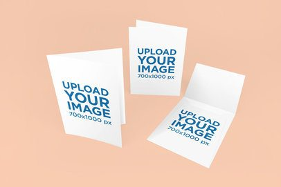 Mockup of Two Greeting Cards and an Envelope Against a Plain Backdrop 1135-el