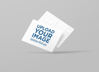Front and Back View Mockup of Two Postcards Floating on a Plain Background 1226-el