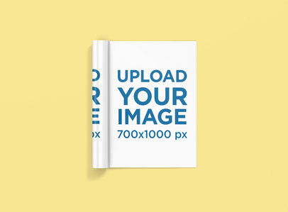 Mockup of a Rolled Magazine Lying Flat on a Customizable Surface 1468-el