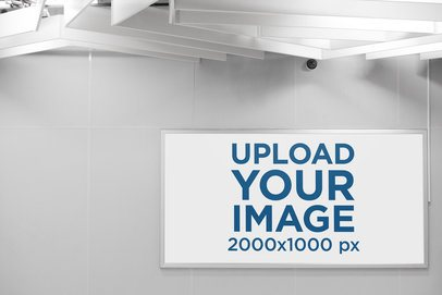 Mockup of an Horizontal Banner Placed on a Wall with a Security Camera 1187-el
