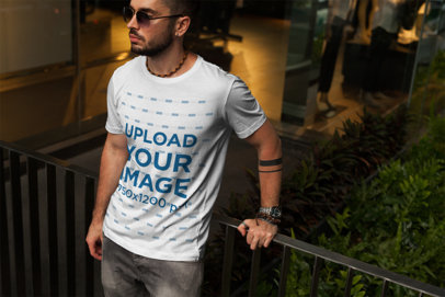 T-Shirt Mockup of a Cool Man Leaning on a Balcony 1194-el