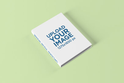 Mockup of an Angled Hardcover Book on a Solid Color Surface 1493 el
