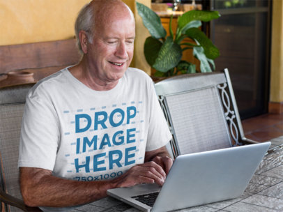 T-Shirt Mockup of a White Senior on His Laptop a11414