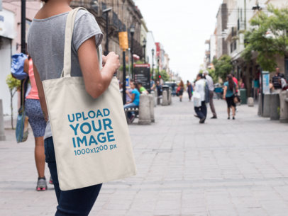 Mockup of a Tote Bag Carried by a Woman in the Street a11452