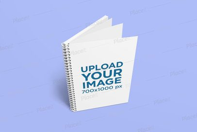 Mockup Featuring a Spiral Notebook Standing on a Plain Color Surface 1634-el1