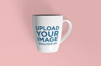 Mockup of an 11 Oz Coffee Mug Placed Against a Plain Color Backdrop 1100-el