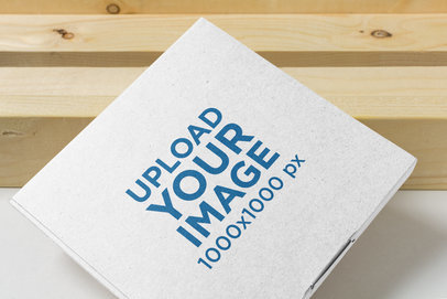 Mailing Box Mockup with a Wooden Background 1664-el