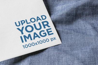 Logo Mockup Featuring a Postcard over a Piece of Fabric 1673-el