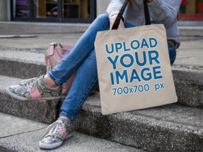 Canvas Tote Bag Mockup of a Young Woman Sitting on Stairs a11491