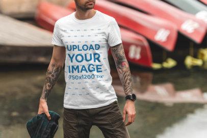 T-Shirt Mockup of a Man Posing by a Lake 1844-el